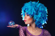 Glamour portrait of a girl in a blue wig
