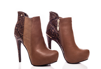 Brown female high-heeled boots