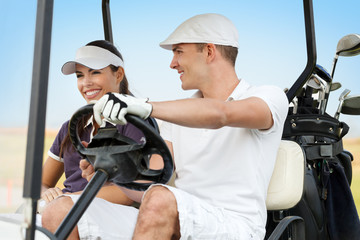 Happy young couple on golf course
