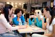 Friends enjoying in a cafe