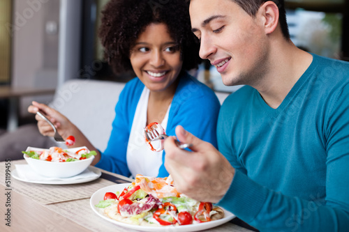 Lovely interracial couple having lunch