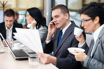businesspeople having a business meeting using laptop computer