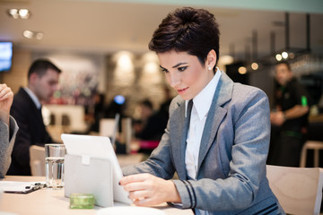 Businesswoman and tablet