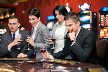 young smiling people enjoying in a  gambling