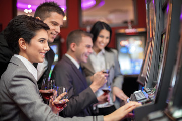 Young people enjoying to play slot machines