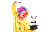 A circus clown performing a magic trick with a top hat and a rab