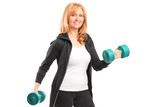 A mature woman lifting up dumbbells