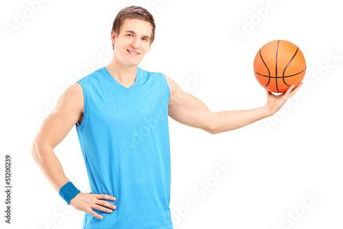 A basketball player posing