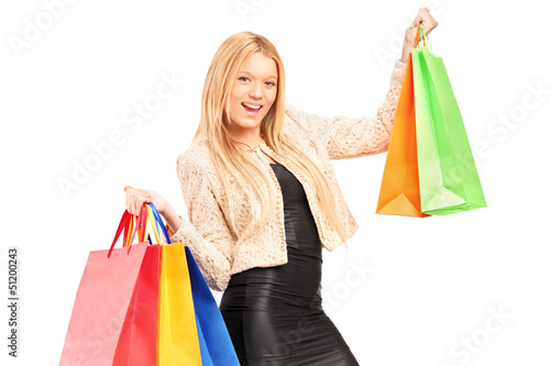 A beautiful young woman holding shopping bags