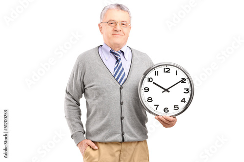 A gentleman holding a wall clock