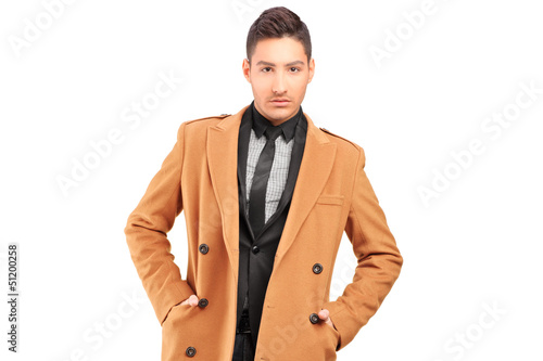 A handsome smiling man wearing coat