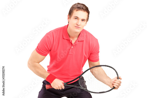 A male tennis player holding a racket
