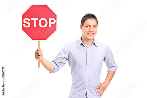 A man holding a traffic sign stop