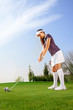 Woman ready to hit the golf ball