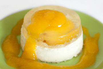 italian panna cotta dessert with apricot sauce and jelly