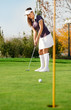 Attractive girl playing golf