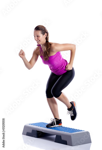 Woman doing step exercise