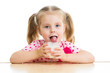 child drinking yogurt or dairy product