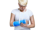 woman holding painful broken arm