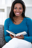 woman in enjoying reading book