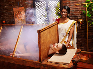 Woman having Ayurveda sauna.