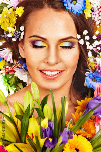 Face of woman with flower.