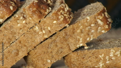 The close-up of rye-bread cutting.