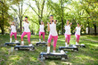 Six women doing exercises outdoor