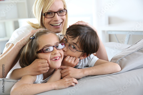 Woman and children with eyeglasses on