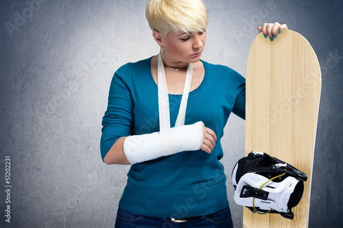 Unhappy snowboarder with  broken arm