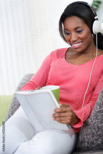 pretty woman with  headphones listening music