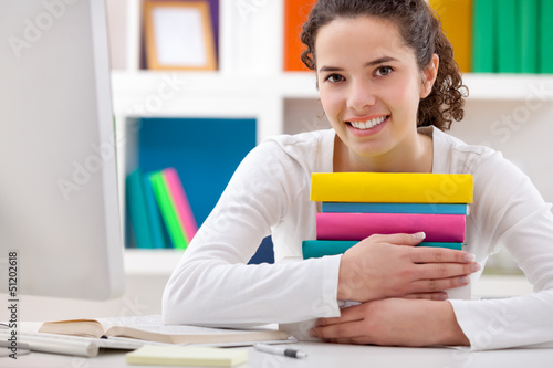 cheerful girl hugging books