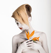 Fantasy. Artistry. Woman with Flower. Trendy Coiffure, Bodyart