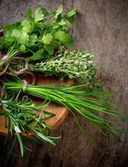 Fresh herbs on wooden table