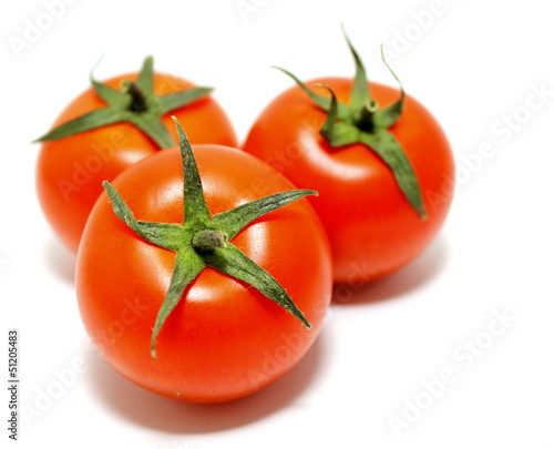 ripe tomatoes on white background