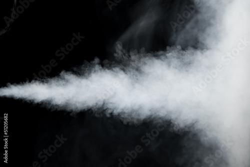 white smoke trail isolated on black
