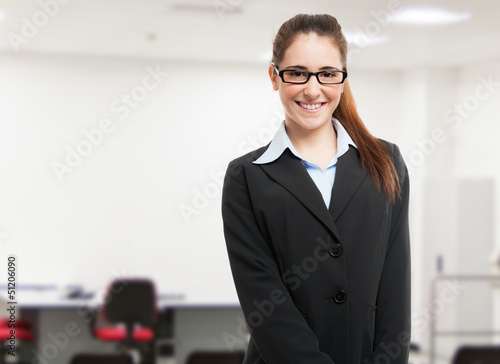 Young smiling woman in a classroom
