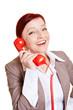 Zufriedene Geschäftfrau telefoniert über Festnetz