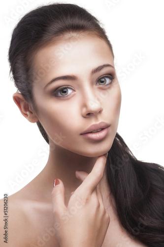 young woman with beautiful long brown hair posing