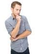 Nachdenklicher junger Mann isoliert in Blau kariert