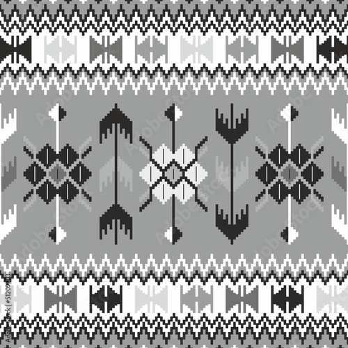 Seamless ethnic pattern background in black and white