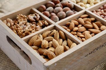 Nut mix in wooden box - walnut, almond, hazelnut, cashew and pea