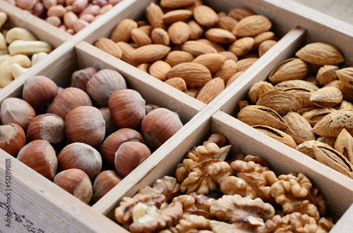 Nut mix in wooden box - walnut, almond, hazelnut, cashew and pea