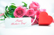 Roses and gift box with a card