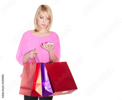 blond woman with shopping bags