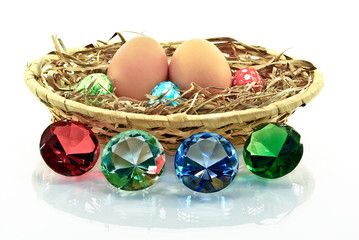 Eggs in the basket ,emeralds isolated on a white background.