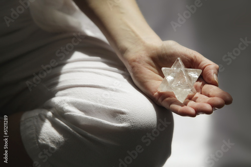 Meditating in sunlight with Merkabah, soft focus