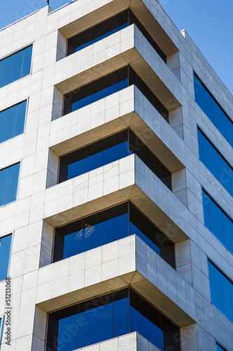 Corner of White Marble Building with Blue Glass Windows