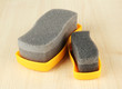 Shoe shine sponges, on wooden background