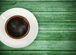 cup of coffee on green wooden table